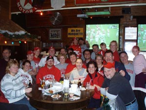 We told you this was a family bar. Some of the Blithe family, shown here, gather to cheer on the Badgers at Goolsby's.